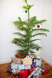 Decorate Christmas Tree Naturally by Photo Of Decorated Christmas Tree With Presents Free Christmas