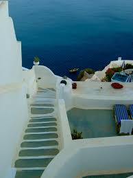 greek white and blue why are the buildings in greece painted