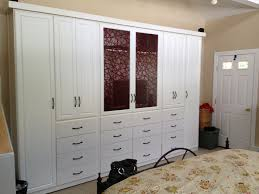 White Wooden Storage Cabinet With Drawers And Door White Wooden 4 Door Wardrobe Closet With Black Knob Handle Cabinet