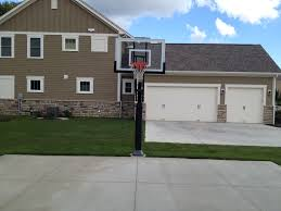 3 Car Garage House by Pro Dunk Silver Basketball System Is Installed In His Front Yard