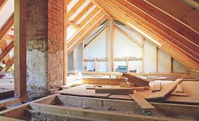 how roofing contractors can help clients with insurance and attic