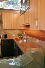 kitchen clear glass with metal and chatham quartz cambria clear glass with metal and chatham quartz cambria countertop with plank cedar and earth slate backsplash also charcoal grey and hickory veneer cabinet and