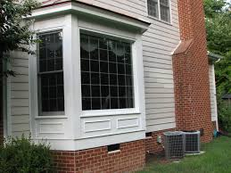 windows exning bow bay window white exterior brick wall home rukle
