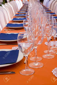 Table Settings For Dinner Orange And Blue Long Table Setting For Dinner Stock Photo Picture
