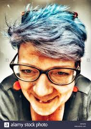 pictures of grey hair with lowlights woman with grey hair and dyed blue lowlights stock photo