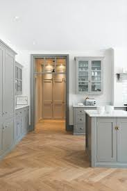 grey kitchen cabinets with brown wood floors design trend herringbone wood floors the house