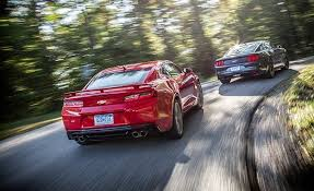 car and driver mustang vs camaro 2016 chevrolet camaro ss vs 2015 ford mustang gt comparison
