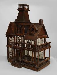 english victorian style stained wood birdcage in the form of a