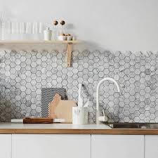 white kitchen cabinets with hexagon backsplash 4 inch white carrara hexagon honed marble mosaic tile