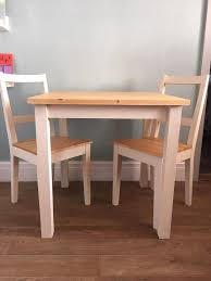 upcycled hand painted ikea dining table and 2 chairs in