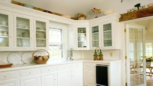 what to put in kitchen cabinets what to put above kitchen cabinets ideas for decorating above