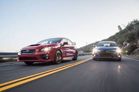 subaru wrx sti 2016 long term test review by car magazine the end of a rivalry mitsubishi lancer evolution mr and subaru