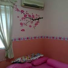 bedroom with wall mural and wallpaper border bring color and