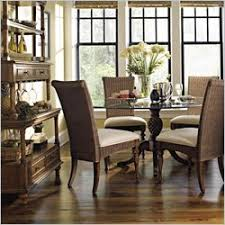 dining room with british colonial style chairs and pineapple table