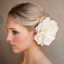 wedding bun hairstyles with flowers indian bridal bun hairstyles