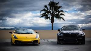lamborghini front view yellow lamborghini and black bmw cars front view wallpaper cars