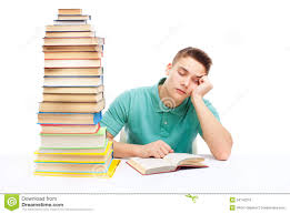 Student At Desk by Stack Of Books On A White Desk Stock Images Image 29310204
