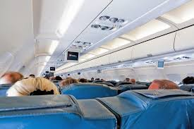 airbus a320 sieges interior of airplane with passengers on seats during flight stock