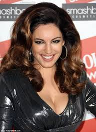 is big hair coming back in style kelly brook goes for a dallas style ensemble in shiny dress and
