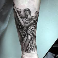 mens forearms guardian and cross tattoos