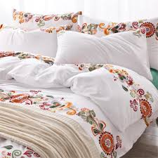 minimalist bedroom design with king size flower bed sheet and