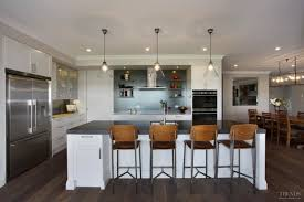 kitchen with reflective splashback and large walk in scullery