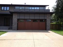 Overhead Door Midland Tx A Stained Steel Garage Door Adds Warmth To This Contemporary Home