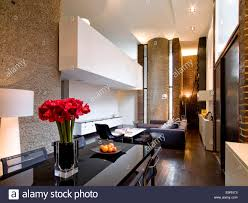 living room and dining room with high ceiling stock photo royalty