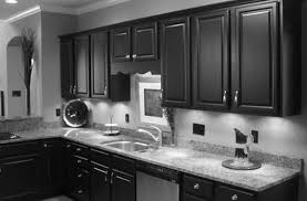 dark cabinets in kitchen white gloss island with white granite top