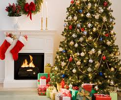 christmas decoration at home christmas tree with presents and fireplace with stockings the