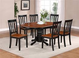 simple dining room with wooden oval century furniture table set