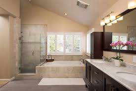 contemporary master bathroom with raised panel u0026 high ceiling in