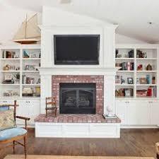 How To Update Brick Fireplace by Custom U0027dressers U0027 In Condo Bedroom In Oak With Electric Fireplace