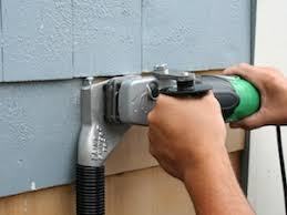Exterior House Painting Preparation - scraping the surface of exterior paint prep buildinggreen