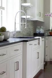 Kitchen White Cabinets Black Countertops 6ba9468b30421e0d94d77bb90653b05d Black Mullions Very Cool Happy