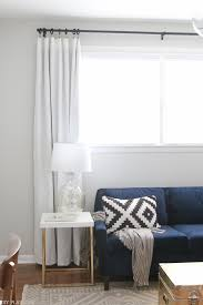 Simple Curtains For Living Room How To Hang Curtains High And Wide To Make Your Window Appear Larger