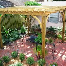 simple backyard landscape ideas wooden pergola with pink paved patio using elegant wrought iron