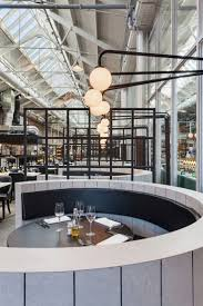 717 best interiors eat drink images on pinterest restaurant a former tram repair depot in amsterdam was converted into a restaurant
