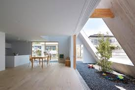 this japanese version of an a frame houses both indoor and outdoor