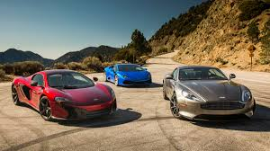 supercar shootout comparo review aston db9 lamborghini huracan