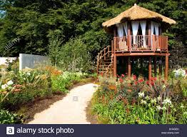 Summer House In Garden - summer house raised on stilts in a large garden stock photo