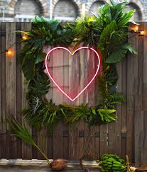 wedding backdrop sign tropical backdrop with green leaves and neon heart by