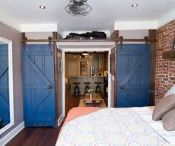 10 ways to incorporate interior barn doors into your new home
