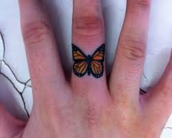 small and simple monarch butterfly on finger golfian com