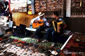glebe flea market sydney jajabawr carlos makes joyous circles of beads and threads while his rich baritone lures all towards his