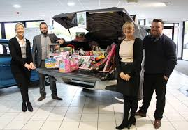 mitsubishi dealership in warrington collects christmas gifts for