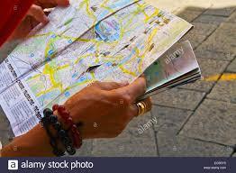 Map Of Verona Italy by Hands Holding Map Of Verona Streets Verona City Italy Stock Photo