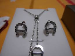 aigner earrings price reduced aigner necklace and earring set 200