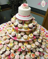 wedding cake and cupcakes cupcake wedding cakes cupcake tower by heavenly confections