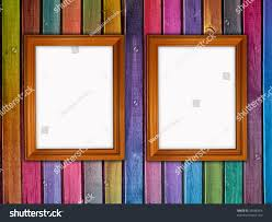 colorful wooden wall two blank frames stock photo 38586664